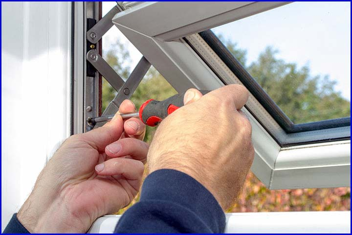 A Hindge being fitted to Window